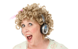 Funny woman in house dress waving with music player