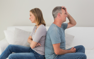 Unhappy couple not talking after an argument in the living room at home