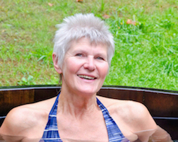 attractive woman soaking in the wooden tub Hot Springs