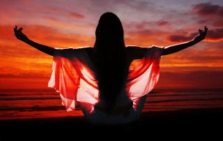 meditation of woman against ocean